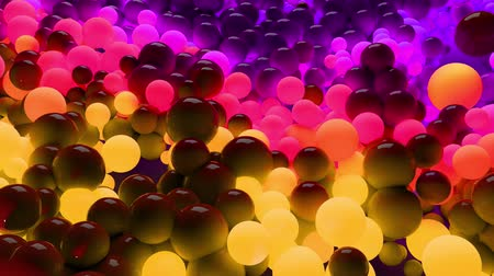 wallow : 3D loop of animation in 4k with beautiful small and large spheres or balls as an abstract holiday background. Beautiful composition of colorful glowing spheres