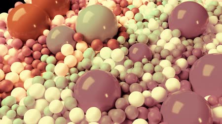 wallow : 3D looped animation with beautiful small and large spheres or balls pastel soft colors as an abstract holiday background. olorful composition of colorful spheres.