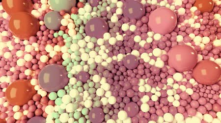 artes plasticas : 3D looped animation with beautiful small and large spheres or balls pastel soft colors as an abstract holiday background. olorful composition of colorful spheres.