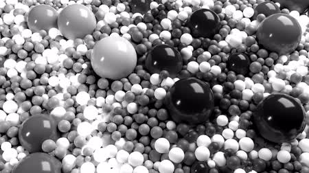 wallow : 4к 3D looped animation with beautiful black and white small and large spheres or balls as an abstract geometric background. Beautiful composition with a plane is covered black and white balls