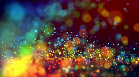 lágyság : glitter magic multicolor particles fly and glow in viscous liquid with amazing shining bokeh for fantastic festive background in 4k. Close-up shot with luma matte as alpha channel. 3d render
