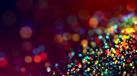 nucleic : glitter magic multicolor particles fly and glow in viscous liquid with amazing shining bokeh for fantastic festive background in 4k. Close-up shot with luma matte as alpha channel. 3d render