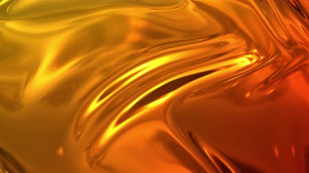 olvasztott : Animated metalic gradient in 4k. 3D render of wavy cloth surface that forms ripples like in liquid metal surface or folds in tissue. Red yellow gradient of foil forms folds in slow motion. 32 Stock mozgókép