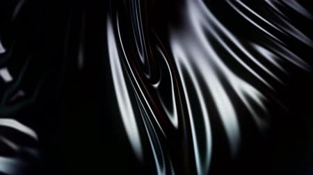 折り目 : 4k 3D animation of wavy black cloth surface that forms ripples like in fluid surface or folds like in tissue. Black silky fabric forms beautiful folds in the air in slow motion. Animated texture. 51