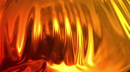 atlaszfényû : Animated metalic gradient in 4k. 3D render of wavy cloth surface that forms ripples like in liquid metal surface or folds in tissue. Red yellow gradient of foil forms folds in slow motion. 23 Stock mozgókép