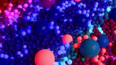 wallow : dark composition with colorful balls that cover the surface, some of which glow. 3d in 4k abstract background with flowing animation of spheres Stock Footage