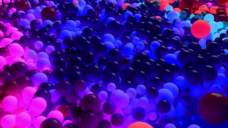 alta calidad : dark composition with colorful balls that cover the surface, some of which glow. 3d in 4k abstract background with flowing animation of spheres Archivo de Video