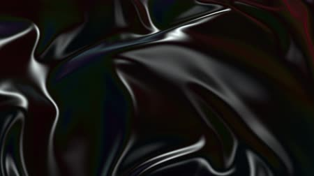 szövetek : Abstract black silky fabric forms beautiful folds in the air in slow motion. 4k 3D animation of wavy tissue surface that forms ripples and folds. Animated texture