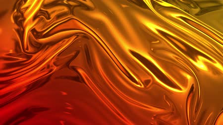 záhyby : Animated metalic gradient in 4k. 3D render of wavy cloth surface that forms ripples like in liquid metal surface or folds in tissue. Red yellow gradient of foil forms folds in slow motion. 11