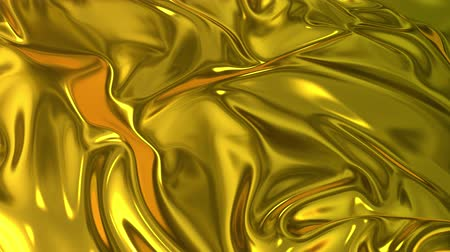 szövetek : Gold silky fabric forms beautiful folds in the air in slow motion. 4k 3D animation of wavy surface forms ripples like in fluid surface and the folds like in tissue. Animated texture. Stock mozgókép