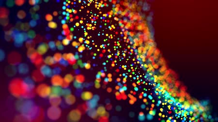 glitter magic multicolored particles fly and glow in viscous liquid with amazing shining bokeh for festive background in 4k. Close-up shot with luma matte as alpha channel. 50