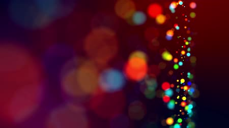 glitter magic multicolored particles fly and glow in viscous liquid with amazing shining bokeh for festive background in 4k. Close-up shot with luma matte as alpha channel. 59