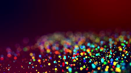 glitter magic multicolored particles fly and glow in viscous liquid with amazing shining bokeh for festive background in 4k. Close-up shot with luma matte as alpha channel. 62