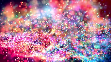 glitter magic multicolored particles fly and glow in viscous liquid with amazing shining bokeh for festive background in 4k. Close-up shot with luma matte as alpha channel. 75