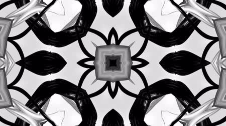 4k seamless looped animation of black and white star pattern with ribbons are twisted and formed complex circular structures as symmetric ornament pattern or kaleidoscope in motion. Stok Video