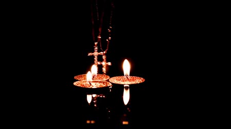padre : candles and crosses made of precious metal with diamonds on the water surface