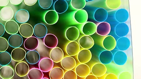 improve : the neatly stacked multi-colored plastic pipes