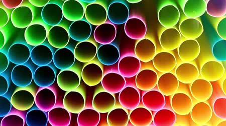 replace : the neatly stacked multi-colored plastic pipes