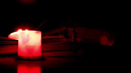 literatura : The pages of old books, the cross and the candle flame Stock Footage