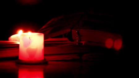 resurrection : The pages of old books, the cross and the candle flame Stock Footage