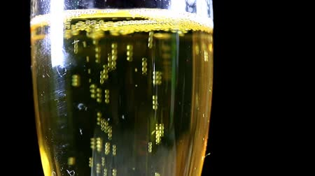 champagne flute : air bubbles in a glass with light sparkling wine