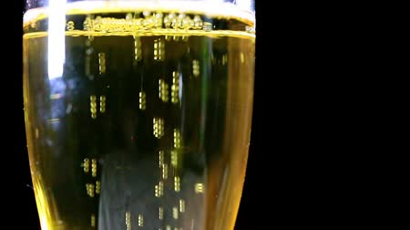 wedding and gold : air bubbles in a glass with light sparkling wine