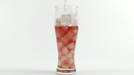 cold drinks : glass filled with ice cubes Stock Footage