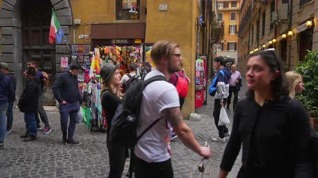 colosseum : Young woman walking in city centre, Slow motion. Female traveler takes photo of old town. Girl exploring Italy. Stock Footage