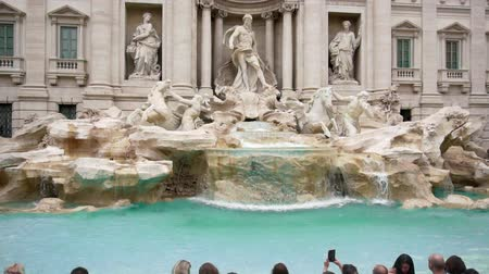 bernini : Many tourists near the Fountain di Trevi in Rome, Italy, Slow Motion, dolly