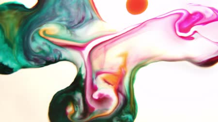 oil drop : Colored liquids mixed together in a fluid-forming manner Stock Footage