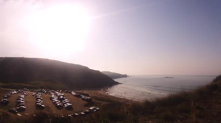 nearly : Time-lapse recording of a beach with visitors and cars in the evening