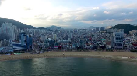 parasol : Aerial View of Cloudy Gwangalli Beach, Gwangalli. Busan, South Korea, Asia Stock Footage