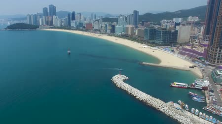 холм : Aerial View of Haeundae Beach from Mipo Port, Busan, South Korea, Asia.