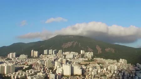bulutluluk : TimeLapse of Clouds on Buildings and mountains, Busan, South Korea, Asia