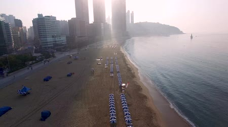日傘 : Sunrise of Summer Haeundae Beach, Busan, south Korea, Asia. 動画素材