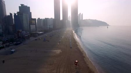 parasol : Sunrise of Summer Haeundae Beach, Busan, south Korea, Asia. Stock Footage