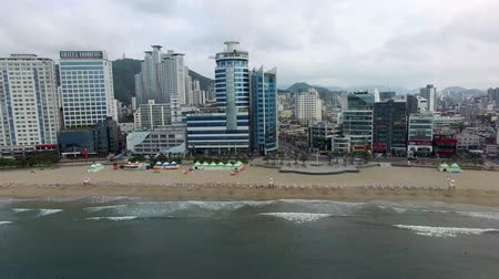 parasol : Aerial View of Cloudy Summer Morning of Gwangalli Beach, Busan, South Korea, Asia Stock Footage