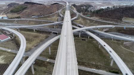 pista de corrida : Hyperlapse Aerial View of Highway Traffic of Daegam JC, Gimhae, Gyeongnam, South Korea, Asia.