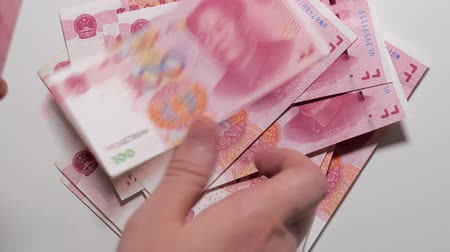 renminbi : Counting chinese money,100 yuan banknotes, chinese currency, white background