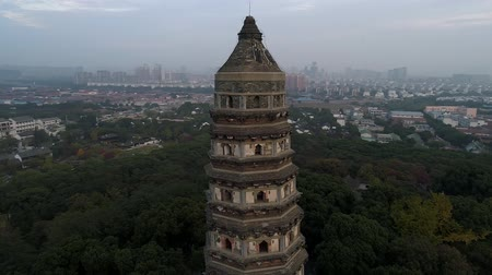 sklízet : Aerial over old historical stone buddhist temple on sunset, Asia, religion