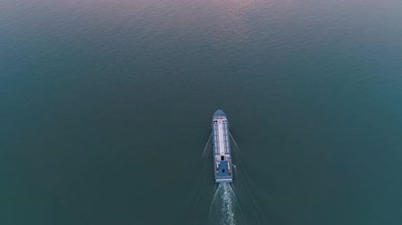 diminishing : Aerial drone view of pleasure boat sails on the lake on sunset