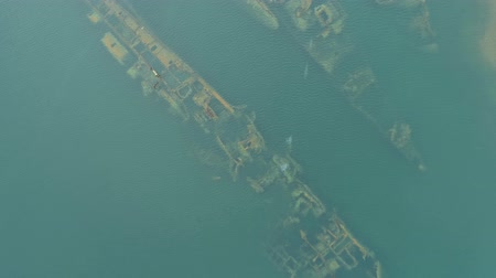 submerge : Aerial view of wreckage submerged warships, abandoned vessels