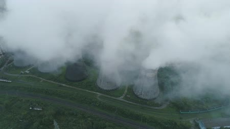 cseppfolyósítás : Aerial drone view of smoking pipes and cooling towers of coal thermal power plant. Thermal power station exhaust steam.