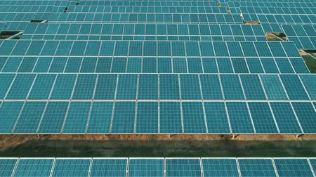 photovoltaic : Aerial drone view of the solar panels in solar farm for green energy. Solar power plants. Renewable energy power plant producing sustainable clean solar energy from the sun