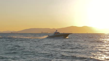 lancha : Black and white private motor yacht in the sea on sunset