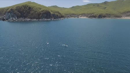 sucção : Aerial drone video of sup between 2 men in tropical caribbean waters