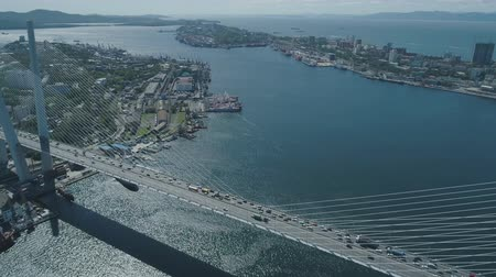 stayed : Aerial drone view of The Zolotoy Golden Bridge. Cable-stayed bridge across the Zolotoy Rog (Golden Horn) in Vladivostok, Russia Stock Footage