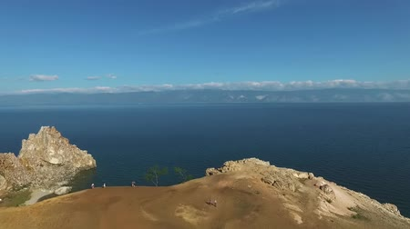 shaman : Aerial view of Shamanka Rock, Olkhon Island, Baikal lake. Scenic unique rock cliff edge, orange mountain, shamanic landscape. Famous Tourist explore.