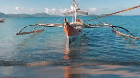 siargao island : Gimbal shot of traditional filipino bangka boats anchored on gorgeous tropical beach. Travel concept. Palawan island, Philippines.