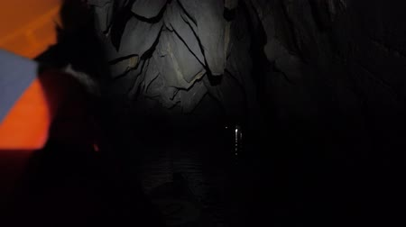 subterranean : Floating inside Underground river by boat, Sabang, Philippines. Dark lighting with the real feeling from visitors point of view. Wonder of the World.
